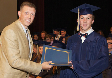 SouthWest Water Company Managing Director Craig Sorensen presents the company's engineering scholarship to Briarwood Christian School graduate John Mason IV of Hoover recently. (Courtesy / SouthWest Water Company)